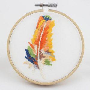 haftowany obrazek ogniste pióro